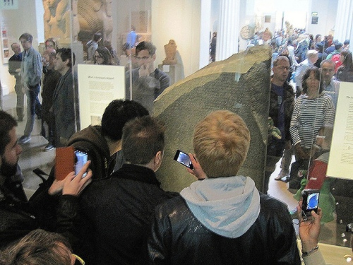 Photographing the Rosetta Stone by Flickr user Snapshooter46 CC-BY-NC-SA 2.0