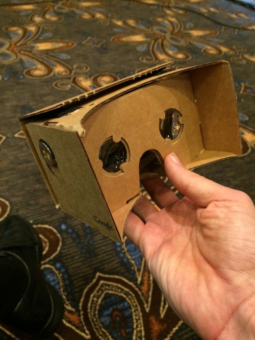 Google cardboard. The advance mechanism (only works w Android phones) is just a washer and a magnet.  Genius!